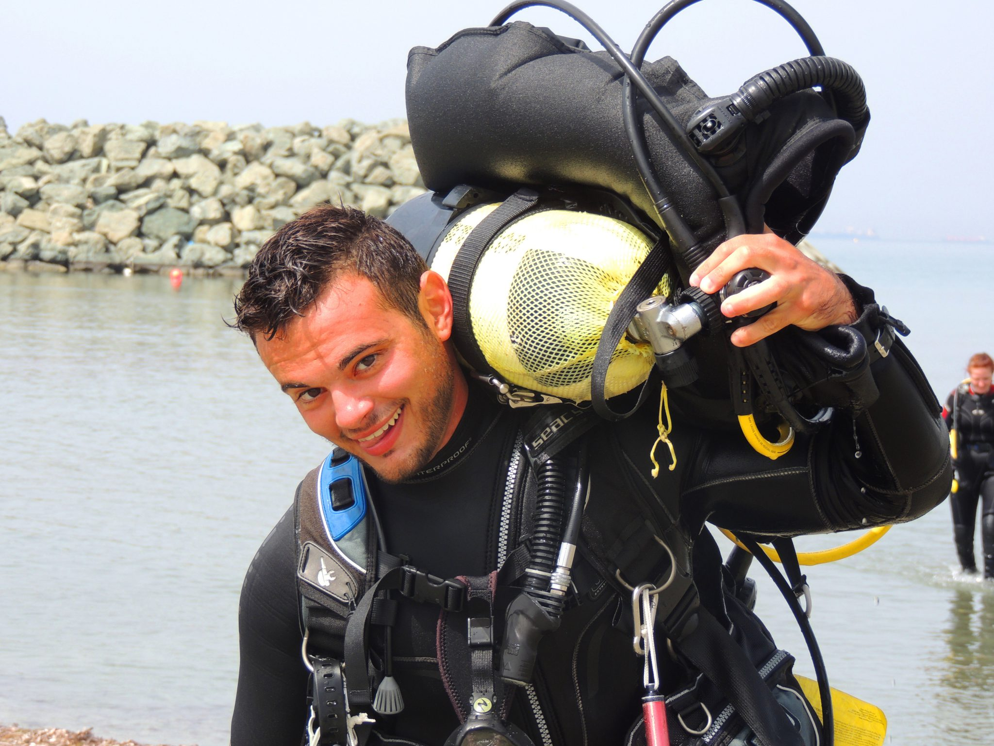 Happy Instructor, carrying gear, smiling, PADI Recreational Courses