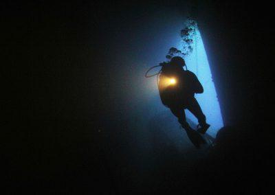 wreck diver, torch, explore, dark